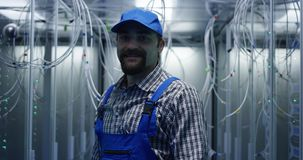 Technician searching through cables. Medium shot of a technician searching through cables at a data center stock photos