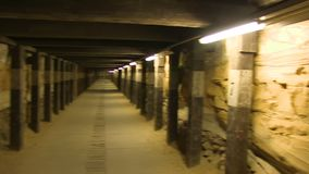 A wall of a tunnel with lights. A medium shot of a tunnel. Camera pans to the right stock video footage