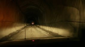 A dark tunnel shot. A medium shot of a tunnel then turned right stock video