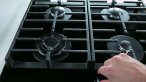 Medium shot of turning on and off gas cooker. Kitchen equipment stock footage