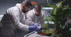 Two scientists examining soil of Martian garden