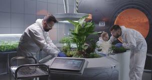 Scientists tending Martian garden