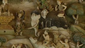 Antique diorama on display in a Buddhist museum. A medium shot with an upward tilting view of a three-dimensional diorama scene depicting the culture and stock video footage