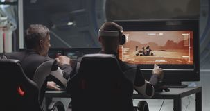 Man controlling Mars rover with remote controller