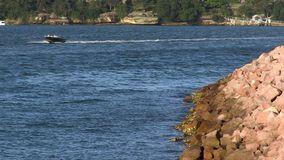 Waters and stones with a boat. A medium shot of waters and stone with a boat stock footage