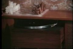 Medium shot of  woman playing record on turntable stock video