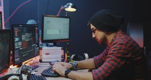 Hackers working at their desks