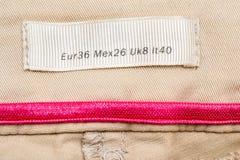 Medium Size. Macro Photo Of A Clothing Label Showing Medium Size (European, Mexican, United Kingdom and Italy Equivalents Stock Photo