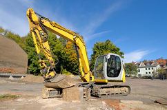 Medium size excavator. Parked on a construction site Royalty Free Stock Photography