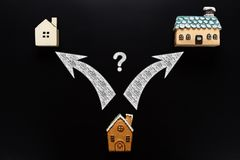 Medium size house with arrows pointing to smaller and bigger houses  clipping path for the arrows & question mark included. Medium size house with arrows stock photography