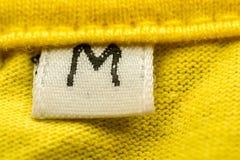 Medium Size Label. Macro Photo Of A Clothing Label Showing Size M (Medium Royalty Free Stock Photo