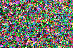 Medium sized Blue/Green/Red/Pink/Yellow Glitter. Macro photo of medium sized blue, green, red, pink, and yellow glitter Stock Photo