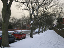 Medium snowfall in the neighborhood on a Winters day Royalty Free Stock Image