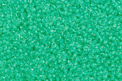 Medium spring green seed beads. Close up of medium spring green seed meads Royalty Free Stock Photos