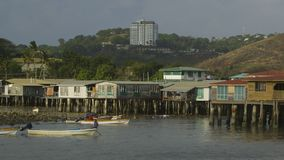 Motorboat owners arriving at the village, Moresby