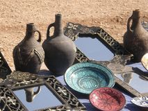 Vases, plates and mirrors. Medium vases at some brown black color, decorated plates, the pale blue is terrific royalty free stock photography