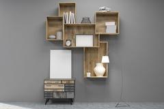 Medium vertical poster under bookshelves in gray room Stock Photo