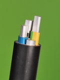 Medium voltage 1kV Aluminum sector cable end with stripped conductors. On green background, PVC insulation and black jacket, Melbourne 2015 Stock Images