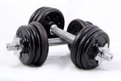 Medium Weight Dumbbells. Medium weighted 8kg pair of dumbbells isolated on white background Royalty Free Stock Photo