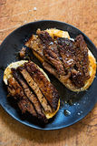 Medium well done cut steak sourdough bread open sandwiches. Medium well done steak sourdough bread open sandwiches royalty free stock photography
