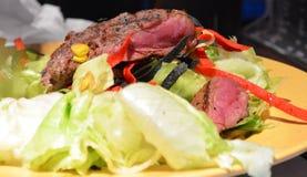 Medium well steak salad Royalty Free Stock Photo