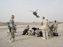 Medevac to surgical. Air Evacuation of an Iraqi casualty to the surgical hospital from a remote aid station in Iraq stock photos