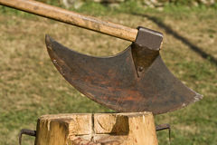 Medival blade. Medival axe on the log in the castle Grimani tournament Royalty Free Stock Photography