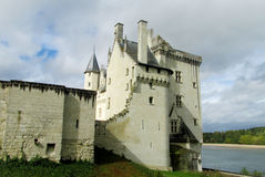 Medival castle in France. Medival castle walls and tower. Fortificated wall on the river bank Stock Photography