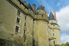Medival castle in France. Medival castle walls and tower. Fortificated wall on the river bank Stock Image