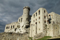 Medival castle ruins Zamek Ogrodzieniec near Krakow. In Poland. Fortificated wall and tower of an ancient castle standing on a hill. Medival castle wall and Royalty Free Stock Image