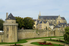 Medival castle wall and towers. Medival castle walls in the city. Fortificated wall among green garden stock photography
