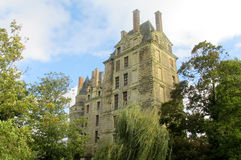 Medival castle. Walls and tower in the city. Fortificated wall among green garden Royalty Free Stock Image