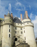Medival castle. Walls and tower in the city. Fortificated wall among green garden Royalty Free Stock Photos