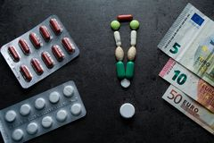 Medizin und Geld Teure Medizin Stockfoto