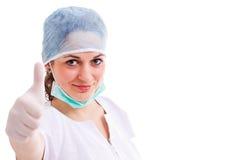 Medizinische assisstant darstellende Daumen oben Stockfotografie