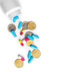 Medizinische Flasche mit Pillen und Münzen Stockbilder