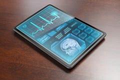 Medizinische Tablette auf Schreibtisch Stockfotografie