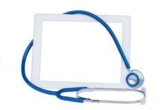 Medizinische Tablette mit blauem Stethoskop Stockfoto