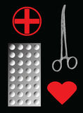 Medizinische Zange und Tablets auf Schwarzem Lizenzfreies Stockfoto