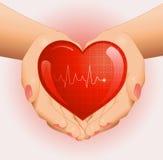 Medizinischer Hintergrund mit Herzen in den Händen Lizenzfreie Stockbilder