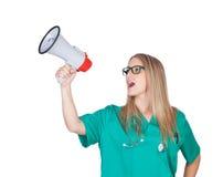 Medizinisches Mädchen Atractive mit einem Megaphon Stockfotos