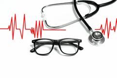 Medizinisches Stethoskop mit Gläsern Übung ist der beste Doktor Lizenzfreies Stockfoto