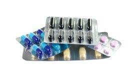 Medizinpillen in den Sätzen Pillen in der Blisterpackung, in den Kapseln und in der Pille verpackten in den Blasen Stockfoto