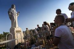 Medjugorie - The place where appear the Virgin Mary. Pilgrims pray on the PODBRDO hill Royalty Free Stock Photos
