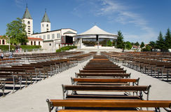 Medjugorje. BOSNIA AND HERZEGOVINA - MAY 18, 2013: Pilgrims visits St. James Church in .  has become one of the most popular pilgrimage sites for Catholics in Stock Photos