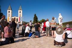 Medjugorje Bosnia and Herzegovina. Unidentified pilgrim praying in front of Statue of Virgin Mary in Medjugorje, Bosnia and Herzegovina Stock Image