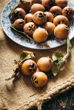 Medlar fruit. On the table, close up Stock Images