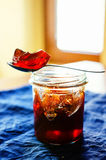 Medlar jelly in a teaspoon Royalty Free Stock Images