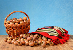 Medlar in a wicker basket and in a etno bag Royalty Free Stock Photos