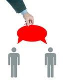 Medling i samtal mellan folk Arkivbild